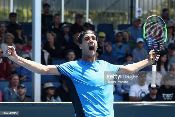 Lorenzo Sonego of Italy celebrates winning his third round match against Bernard Tomic of Australia during 2018 Australian Open Qualifying at...