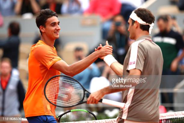 Lorenzo Sonego of Italy congratulates opponent Roger Federer of Switzerland on victory following their mens singles first round match during Day one...
