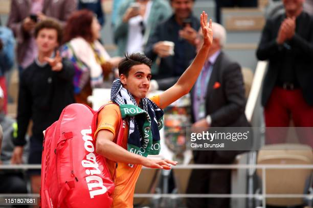 Lorenzo Sonego of Italy leaves the court following defeat in his mens singles first round match against Roger Federer of Switzerland during Day one...