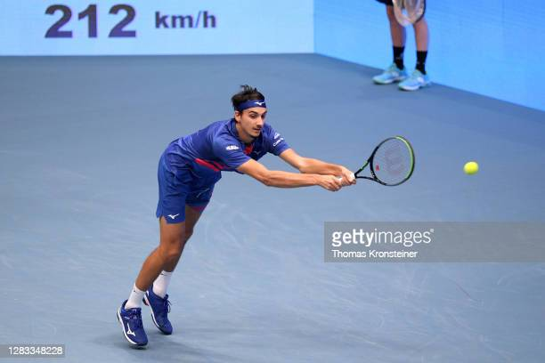 Lorenzo Sonego of Italy misses the ball in his final match against Andrey Rublev of Russia on day nine of the Erste Bank Open tennis tournament at...