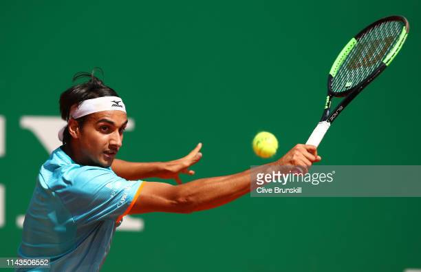 Lorenzo Sonego of Italy plays a backhand against Cameron Norrie of Great Britain in their third round match during day five of the Rolex MonteCarlo...