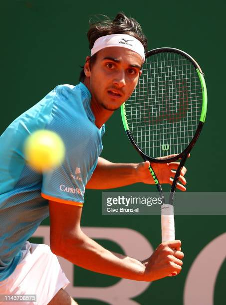 Lorenzo Sonego of Italy plays a backhand against Dusan Lajovic of Serbia in their quarter final match during day six of the Rolex MonteCarlo Masters...