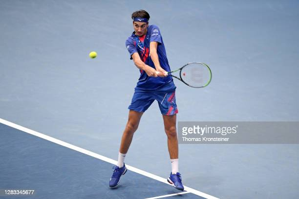 Lorenzo Sonego of Italy plays a backhand in his final match against Andrey Rublev of Russia on day nine of the Erste Bank Open tennis tournament at...