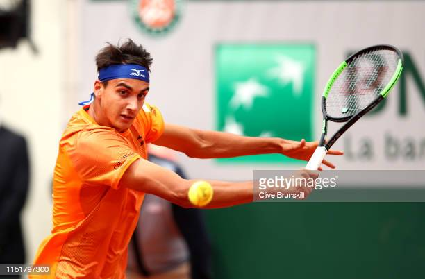 Lorenzo Sonego of Italy plays a backhand in his mens singles first round match against Roger Federer of Switzerland during Day one of the 2019 French...