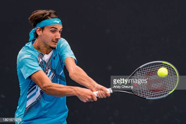 Lorenzo Sonego of Italy plays a backhand in his Men's Singles second round match against Feliciano Lopez of Spain during day four of the 2021...