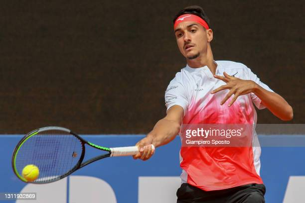 Lorenzo Sonego of Italy plays a forehand in his final match against Laslo Djere of Serbia at the Sardegna Open on April 11, 2021 in Cagliari, Italy.
