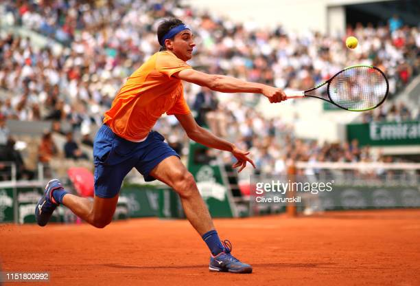 Lorenzo Sonego of Italy plays a forehand in his mens singles first round match against Roger Federer of Switzerland during Day one of the 2019 French...