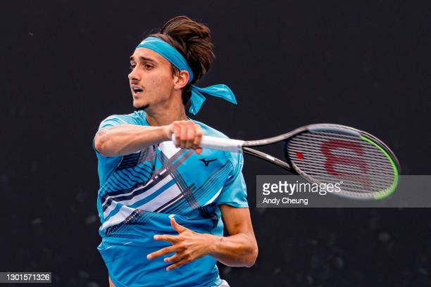 Lorenzo Sonego of Italy plays a forehand in his Men's Singles second round match against Feliciano Lopez of Spain during day four of the 2021...