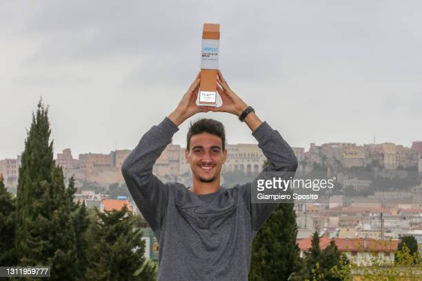 Lorenzo Sonego of Italy poses with trophy after winning his final match against Laslo Djere of Serbia at the Sardegna Open on April 11, 2021 in...