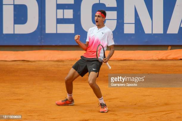 Lorenzo Sonego of Italy reacts after winning a game in his final match against Laslo Djere of Serbia at the Sardegna Open on April 11, 2021 in...