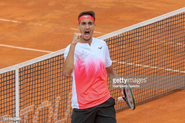 Lorenzo Sonego of Italy reacts after winning the second set in his final match against Laslo Djere of Serbia at the Sardegna Open on April 11, 2021...