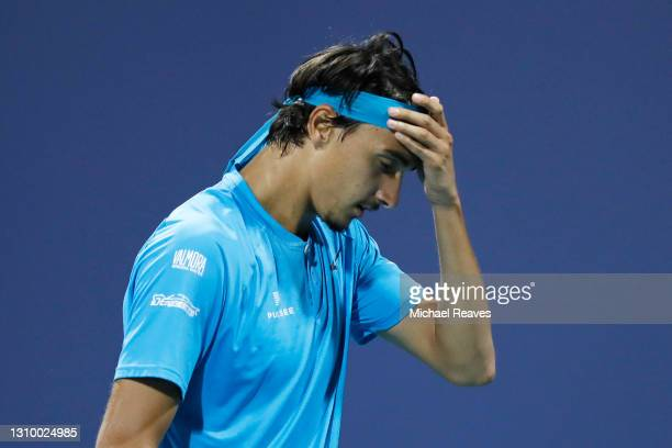 Lorenzo Sonego of Italy reacts in his match against Stefanos Tsitsipas of Greece during the Miami Open at Hard Rock Stadium on March 30, 2021 in...