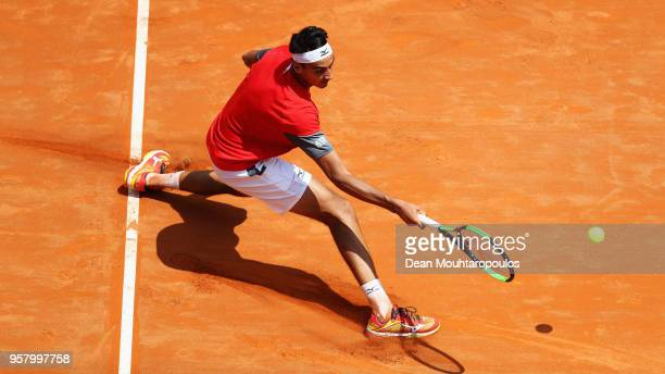 Lorenzo Sonego of Italy returns a forehand in his match against Adrian Mannarino of France during day one of the Internazionali BNL d'Italia 2018...