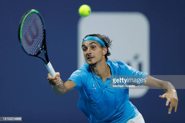 Lorenzo Sonego of Italy returns a shot to Stefanos Tsitsipas of Greece during the Miami Open at Hard Rock Stadium on March 30, 2021 in Miami Gardens,...