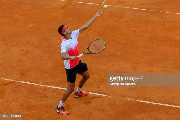 Lorenzo Sonego of Italy serves a ball in his final match against Laslo Djere of Serbia at the Sardegna Open on April 11, 2021 in Cagliari, Italy.