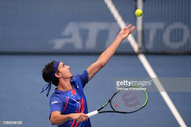 Lorenzo Sonego of Italy serves in his final match against Andrey Rublev of Russia on day nine of the Erste Bank Open tennis tournament at Wiener...
