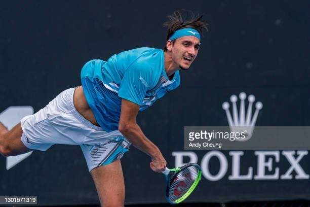 Lorenzo Sonego of Italy serves in his Men's Singles second round match against Feliciano Lopez of Spain during day four of the 2021 Australian Open...