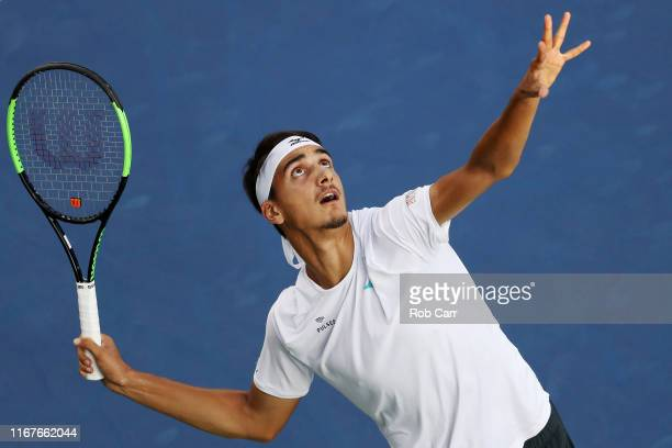 Lorenzo Sonego of Italy serves to Nick Kyrgios of Australia during Day 3 of the Western and Southern Open at Lindner Family Tennis Center on August...