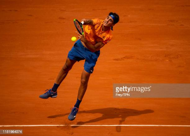 Lorenzo Sonego of Italy serves to Roger Federer of Switzerland in the first round of the men's singles during Day 1 of the 2019 French Open at Roland...