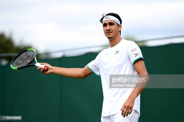 Lorenzo Sonego of Italy speaks with the referee in his Men's Singles first round match against Marcel Granollers of Spain during Day one of The...