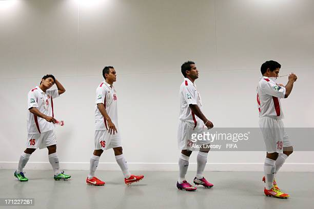 Lorenzo Tehau Ricky Aitamai Samuel Hnanyine and Vincent Simon of Tahiti walk out of the dressing room during the FIFA Confederations Cup Brazil 2013...