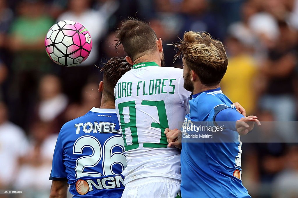 Lorenzo Tonelli of Empoli FC battles for the ball with Antonio Floro FLores of US Sassuolo Calcio during the Serie A match between Empoli FC and US Sassuolo Calcio at Stadio Carlo Castellani on October 4, 2015 in Empoli, Italy.