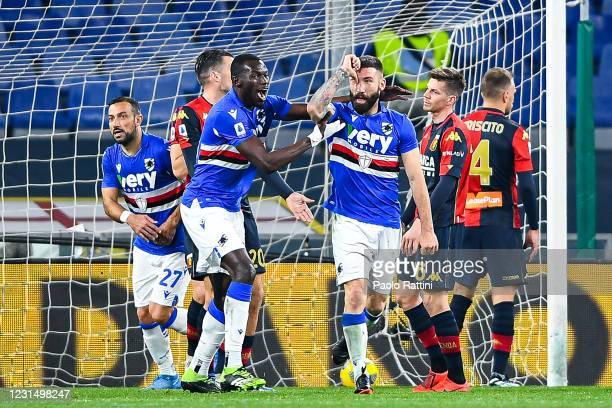 Lorenzo Tonelli of Sampdoria celebrates with his team-mates Fabio Quagliarella and Omar Colley after scoring a goal during the Serie A match between...