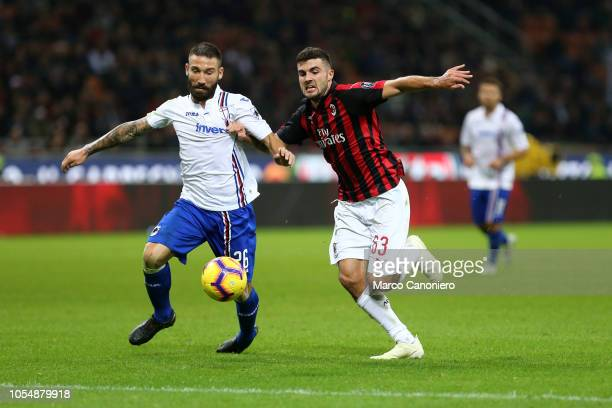 Lorenzo Tonelli of Uc Sampdoria and Patrick Cutrone of Ac Milan in action during the Serie A football match between AC Milan and Uc Sampdoria Ac...