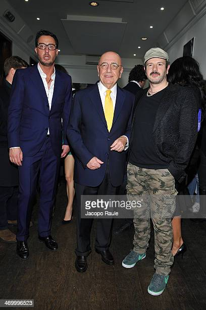 Lorenzo Tonetti Adriano Galliani and Alan Gelati attend 'The Faces' Opening Exhibition on February 17 2014 in Milan Italy