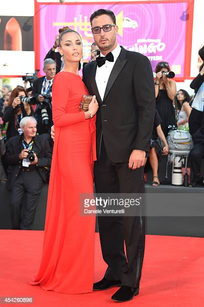 Lorenzo Tonetti and guest attend the Opening Ceremony and 'Birdman' premiere during the 71st Venice Film Festival at Palazzo Del Cinema on August 27...