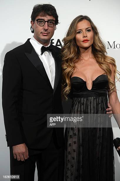 Lorenzo Tonetti and Natalia Borges pose upon arrival for the fourth annual benefit for AIDS research of the amfAR on September 22 2012 during the...