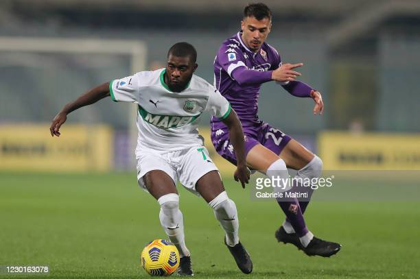 Lorenzo Venuti of ACF Fiorentina battles for the ball with Jeremie Boga of US Sassuolo during the Serie A match between ACF Fiorentina and US...