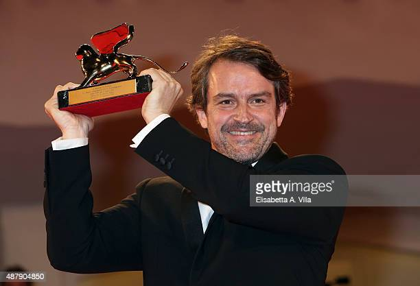 Lorenzo Vigas shows his Golden Lion for the Best Film 'From Afar' on the red carpet during the 72nd Venice Film Festival on September 12 2015 in...
