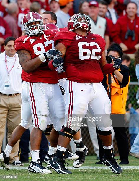 Lorenzo Washington celebrates with Terrence Cody of the Alabama Crimson Tide after Cody blocked a field goal in the first half against the Tennessee...