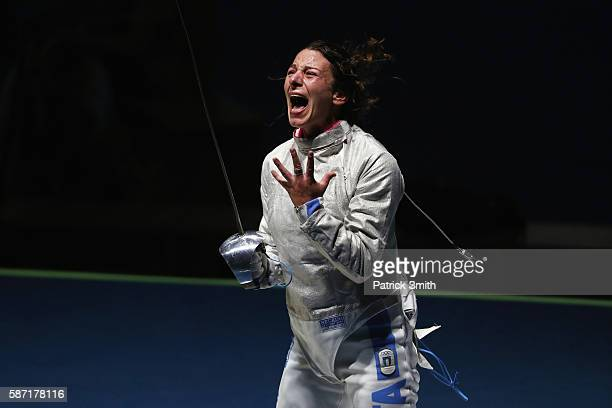 Loreta Gulotta of Italy celebrates victory over Jiyeon Kim of Korea during the Women's Individual Sabre on Day 3 of the Rio 2016 Olympic Games at...