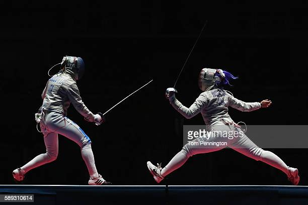 Loreta Gulotta of Italy competes against Dagmara Wozniak of the United States during the Women's Sabre Team bronze medal match between United States...