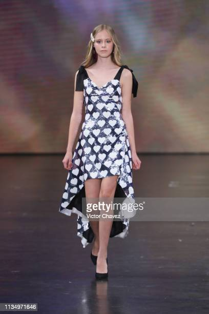 Loreto Peralta walks the runway during the Pink Magnolia fashion show as part of the MercedesBenz Fashion Week Mexico Fall/Winter 2019 Day 4 at...