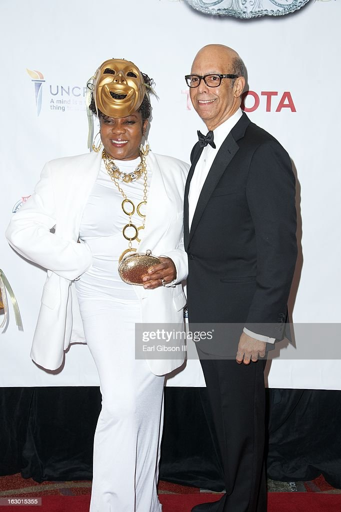 Loretta Devine and Dr. Michael Lomax (President/CEO of UNCF) pose for a photo on the red carpet at the UNCF Mayor's Masked Ball Hosted By Mayor Antonio Villaraigosa at Hilton Universal City on March 2, 2013 in Universal City, California.