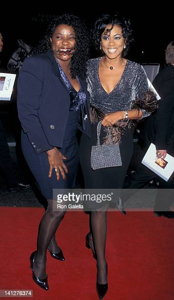Loretta Devine and Lela Rochon at the Premiere of 'Cinderella' Mann Chinese Theater Hollywood