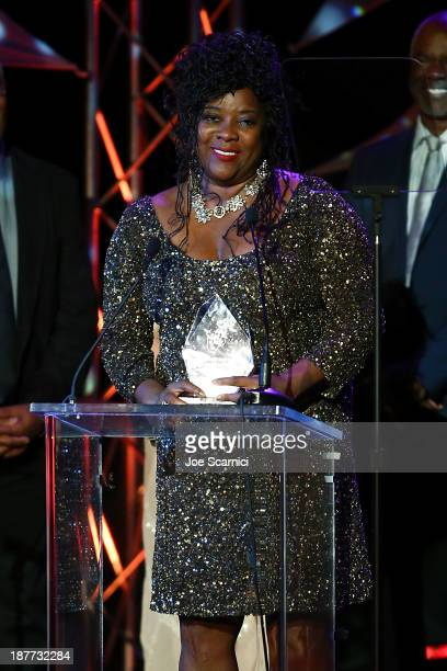 Loretta Devine receives an award onstage at the 23rd annual NAACP Theatre Awards at Saban Theatre on November 11 2013 in Beverly Hills California