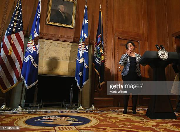 Loretta Lynch blows a kiss and says thank you to Judiciary Committee Chairman Patrick Leahy after being sworn in as Attorney General as her husband...