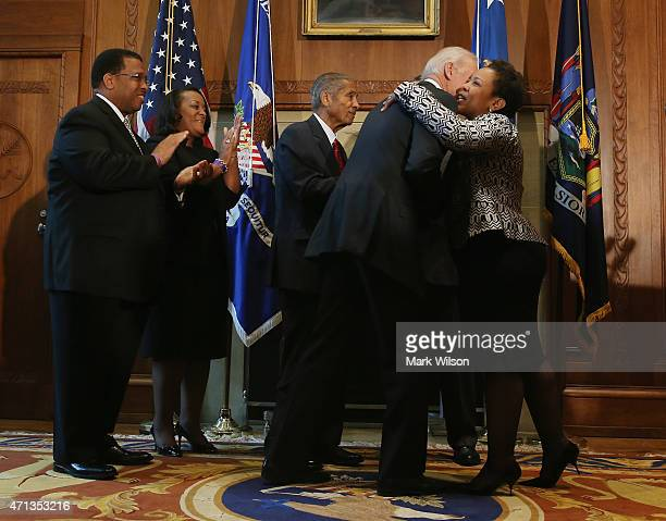 Loretta Lynch hugs US Vice President Joe Biden after being sworn in as Attorney General at the Justice Department April 27 2015 in Washington DC...
