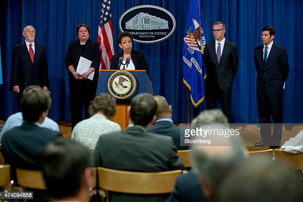 Loretta Lynch US attorney general center speaks during a news conference on financial institutions' longrunning manipulation of the Foreign Exchange...