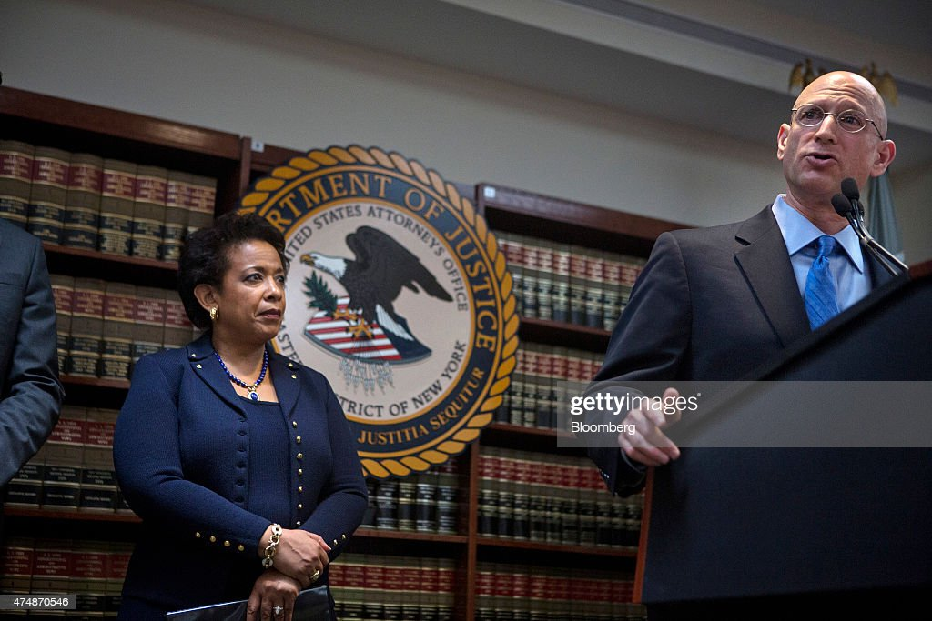 Loretta Lynch, U.S. attorney general, left, looks on as Richard Weber, chief of criminal investigation for the Internal Revenue Service (IRS), speaks during a news conference in the Brooklyn borough of New York, U.S., on Wednesday, May 27, 2015. The future of the World Cup has been called into question and soccer's governing body plunged into crisis after U.S. prosecutors charged nine officials with corruption and Switzerland probed upcoming tournaments awarded to Russia and Qatar. Photographer: Victor J. Blue/Bloomberg via Getty Images