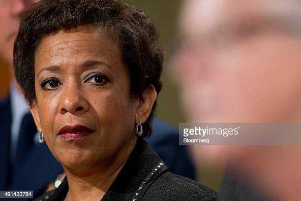 Loretta Lynch, U.S. Attorney general, looks on as Gina McCarthy, administrator of the Environmental Protection Agency, speaks during a news...