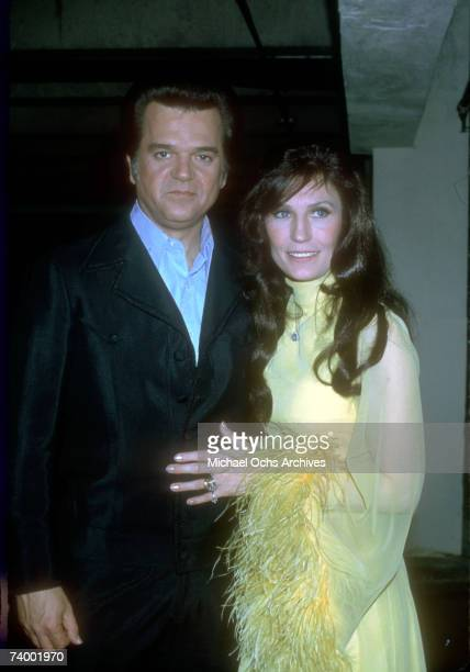 Loretta Lynn and Conway Twitty pose for a portrait backstage at the 2nd annual American Music Awards where they won the award for favorite country...