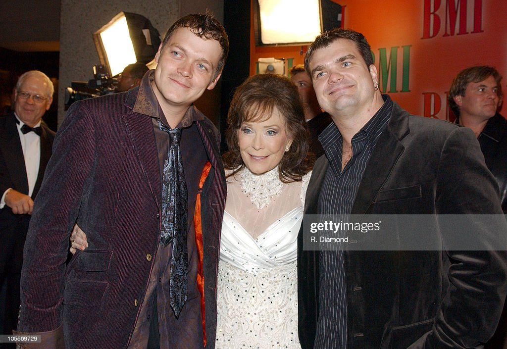 Loretta Lynn (center) Brad Arnold and Chris Henderson of 3 Doors Down