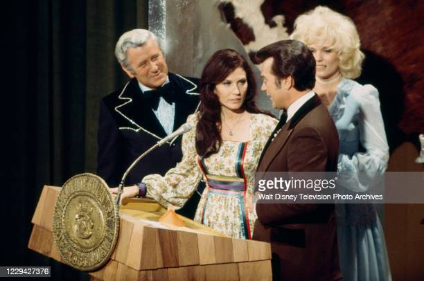 Loretta Lynn, Conway Twitty accepting their award on the ABC tv special '1976 / 11th Academy of Country Music Awards', at the Palladium.