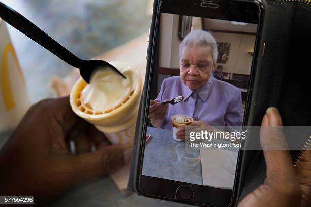 Loretta Veney looks at a picture she just took of her mother Doris Woodward eating ice cream in McDonalds in Ft Washington MD on June 29 2016 Her...