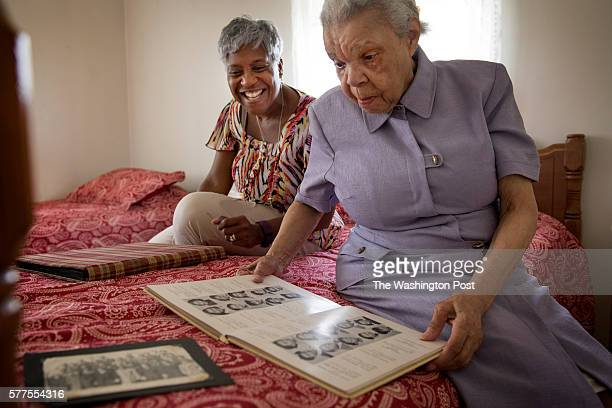 Loretta Veney looks at scrap and yearbooks with her mother Doris Woodward who has dementia and lives in a group home in Ft Washington MD on June 29...